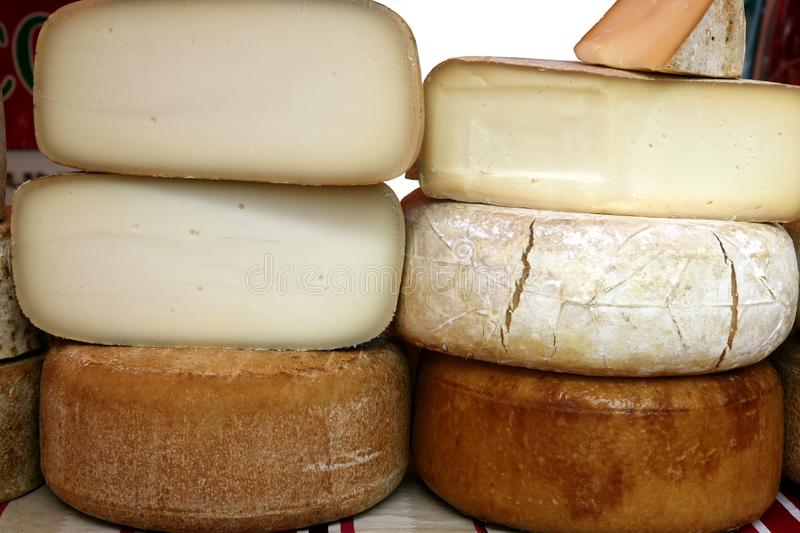 Aged french cheese wheels stacked. On the marketplace royalty free stock photo