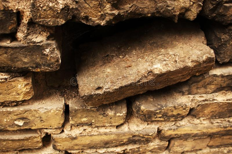 Aged gray concrete tiles stacked into a brick wall stock image