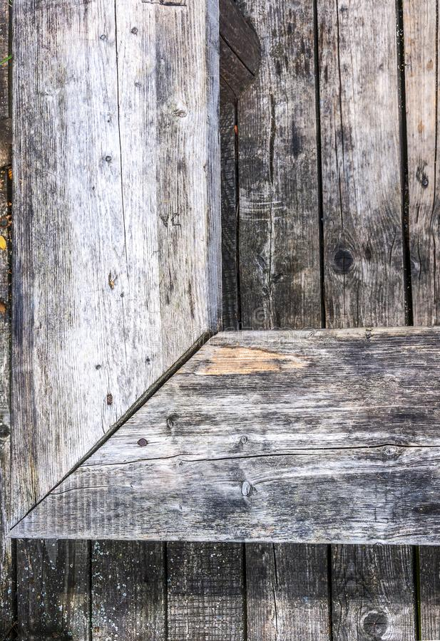 Aged gray nonpainted surface wooden bench and planks texture background royalty free stock photography