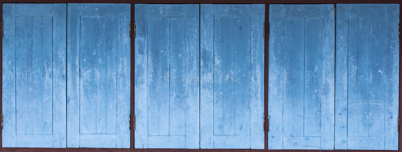Aged grunge weathered blue door wood texture. Mediterranean background stock photos