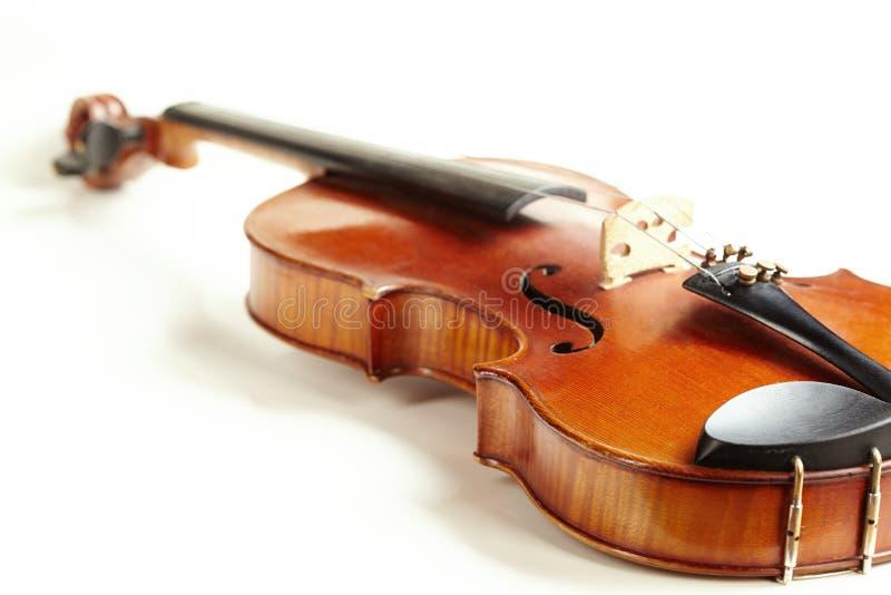 Aged handmade violin on white background. Aged handmade violin isolated on white background stock photo