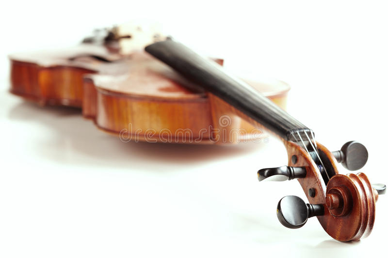 Aged handmade violin on white background. Aged handmade violin isolated on white background stock photography