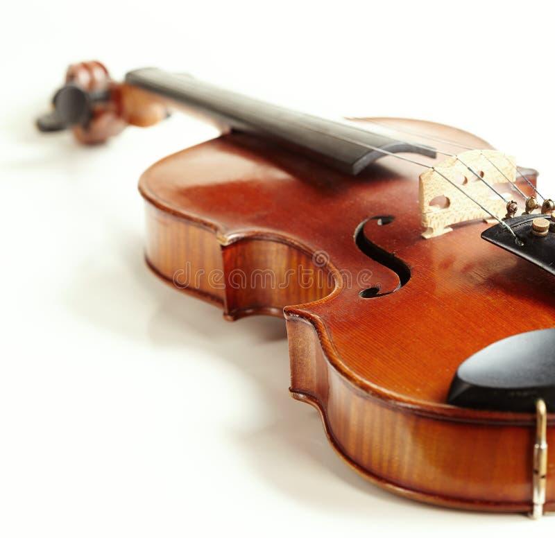 Aged handmade violin on white background. Aged handmade violin isolated on white background stock image