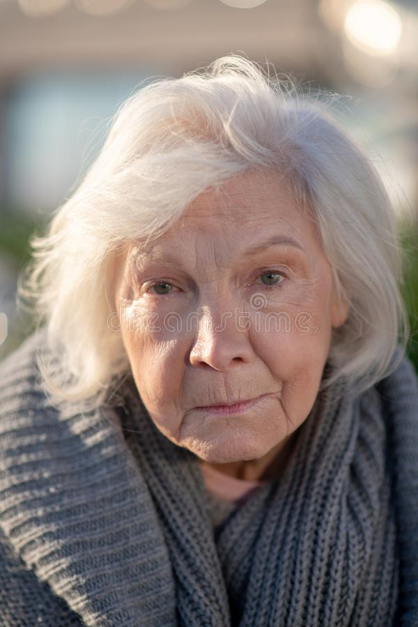 Free Aged Homeless Woman With Facial Wrinkles Feeling Unprotected Stock Photos - 164236703