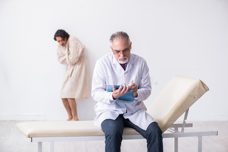 The the aged male doctor psychiatrist examining young patient stock images