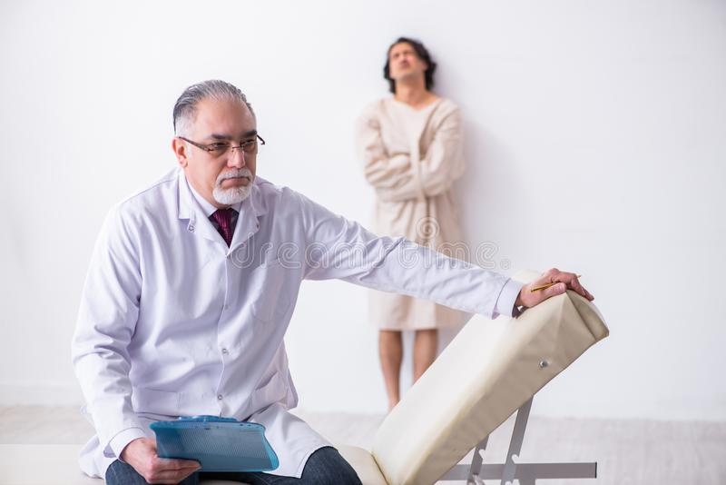 Aged male doctor psychiatrist examining young patient. The aged male doctor psychiatrist examining young patient stock images