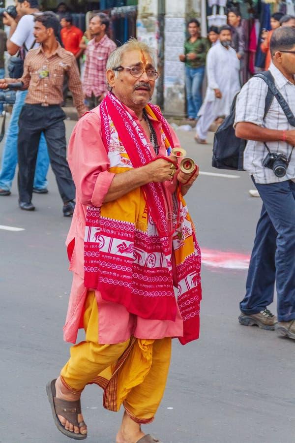 An Aged Man Participate on Iskon Rath Yatra. An old aged man participating on Iskon Rath Yatra at Kolkata stock photography