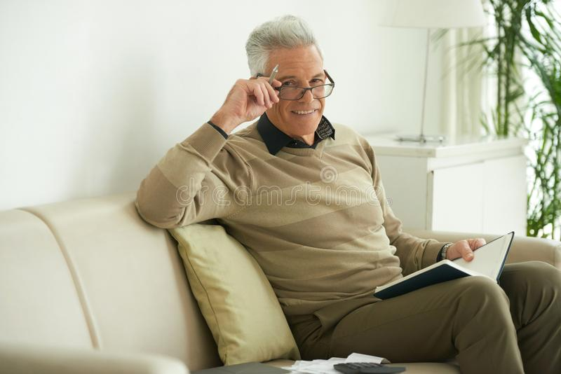 Aged man with planner royalty free stock photo