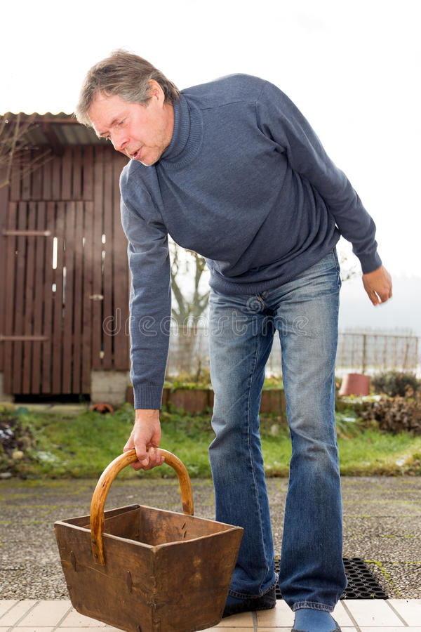 Aged man with rheumatism. Elderly man with painful rheumatism stock photo