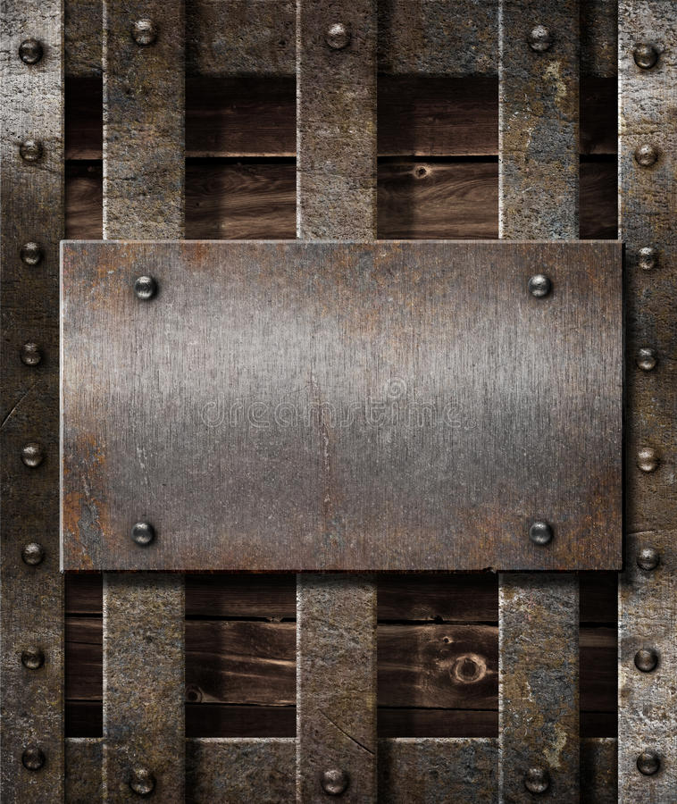Aged metal plate on wooden medieval background stock photos