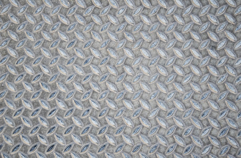 Aged metal seamless steel diamond plate texture pattern background royalty free stock photography