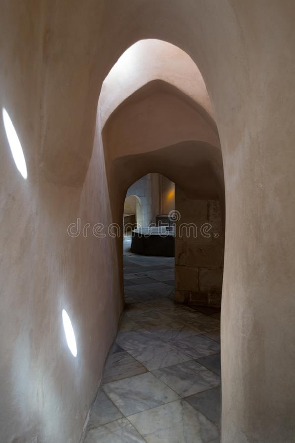 Aged narrow stone vaulted passage, historical traditional Hamam Inal public bathhouse, Cairo, Egypt. Aged narrow dark stone vaulted passage at historical royalty free stock images