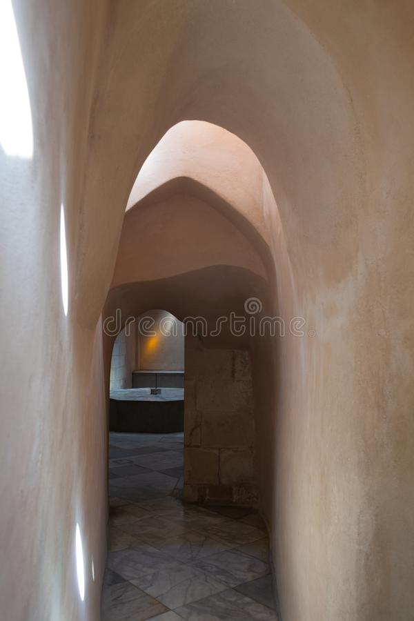 Aged narrow stone vaulted passage, historical traditional Hamam Inal public bathhouse, Cairo, Egypt. Aged narrow dark stone vaulted passage at historical stock photos