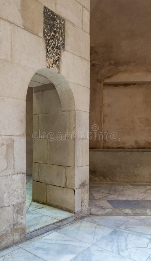 Aged narrow vaulted passage and stone bricks wall. Medieval Cairo, Egypt stock images