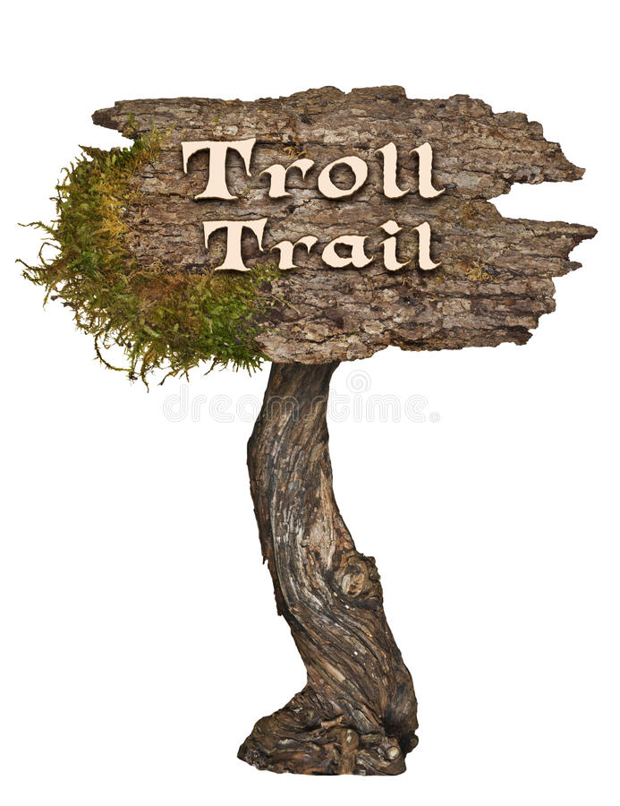Aged natural wood sign with letters Troll Trail stock images