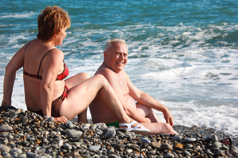 Download Aged Pair Sit On Pebble Beach Stock Photo - Image: 11009224
