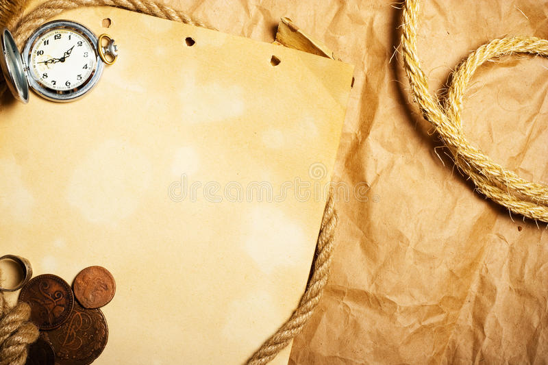aged paper with antique watch royalty free stock photo
