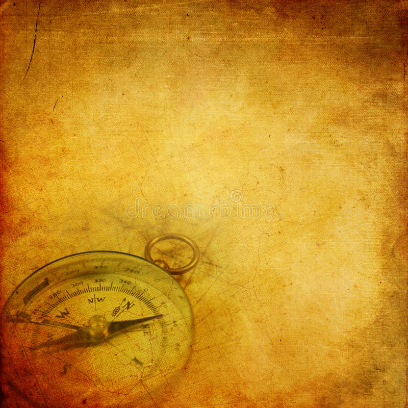 Aged paper with compass. Aged paper background with an old compass and map pattern stock illustration