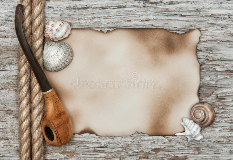 Aged paper with rope and tobacco pipe stock photos