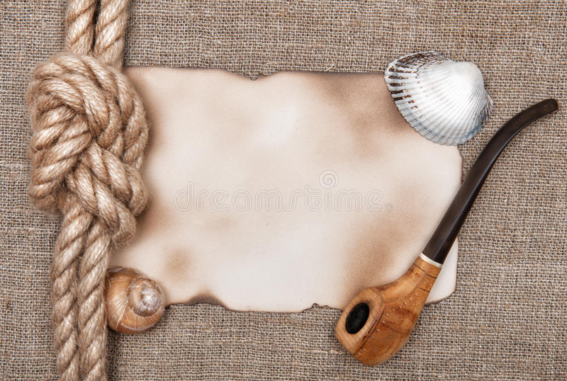 Aged paper with ship rope and tobacco pipe stock photos