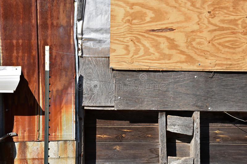 Aged Patchwork of Mixed Building Elements. A panel patched wall of different building material elements stock photos