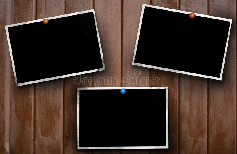 Aged photo frames. Attach to wood background royalty free stock image