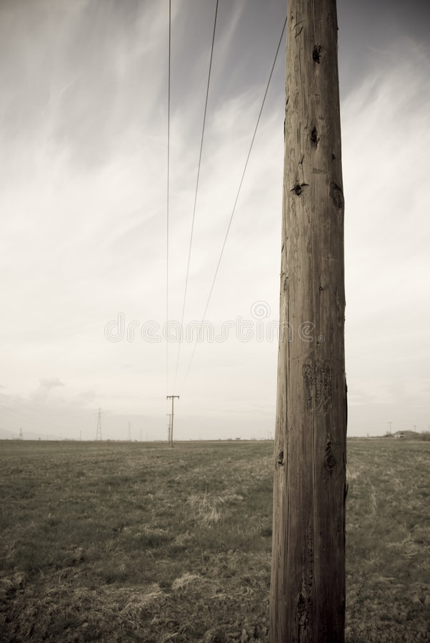 Aged photo telephone pole. The feel of an aged photo of telephone wire pole stock image