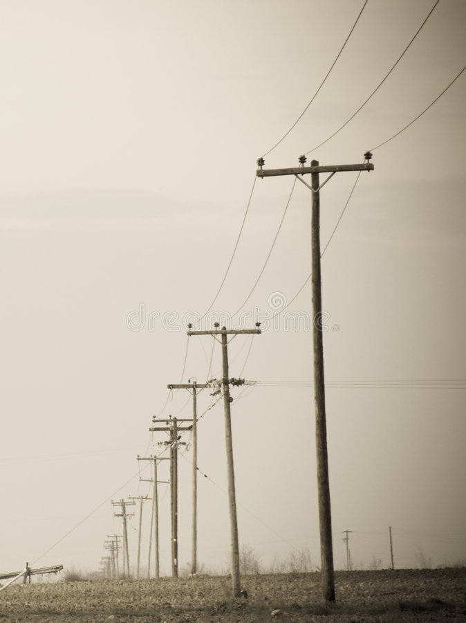 Aged photo telephone pole. The feel of an aged photo of telephone wire pole royalty free stock image
