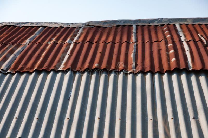 Aged rusty old tin roof iron metal texture. S royalty free stock photography