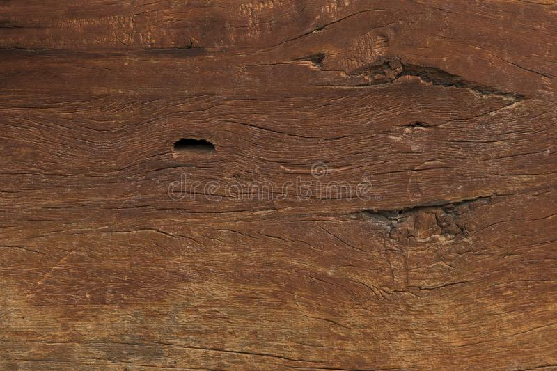 Close-up of Aged Solid Wood Slat Rustic Shabby Brown Background. Grunge Faded Wood Board Panel Structure. stock photo