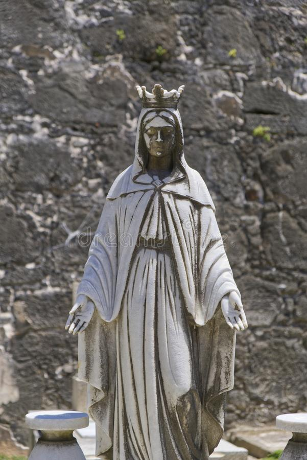 Aged Statue Praying Over Grave stock photography