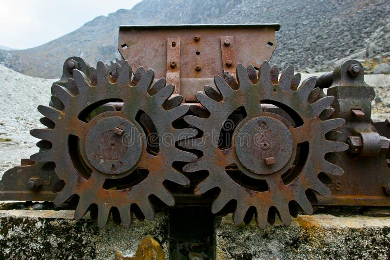 Aged technology: Old and rusty gearwheel, retro and vintage look machinery stock images