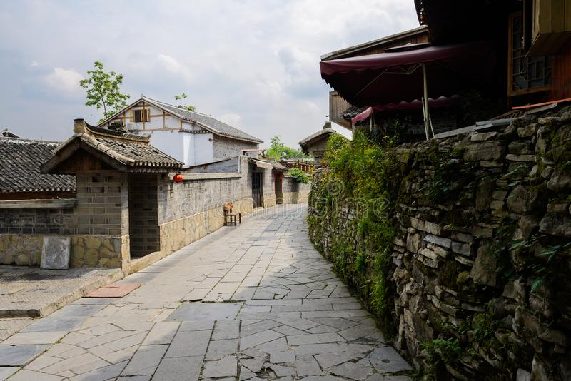 Aged tile-roofed houses along stone street in cloudy spring. Qingyan town,Guiyang,China royalty free stock photography