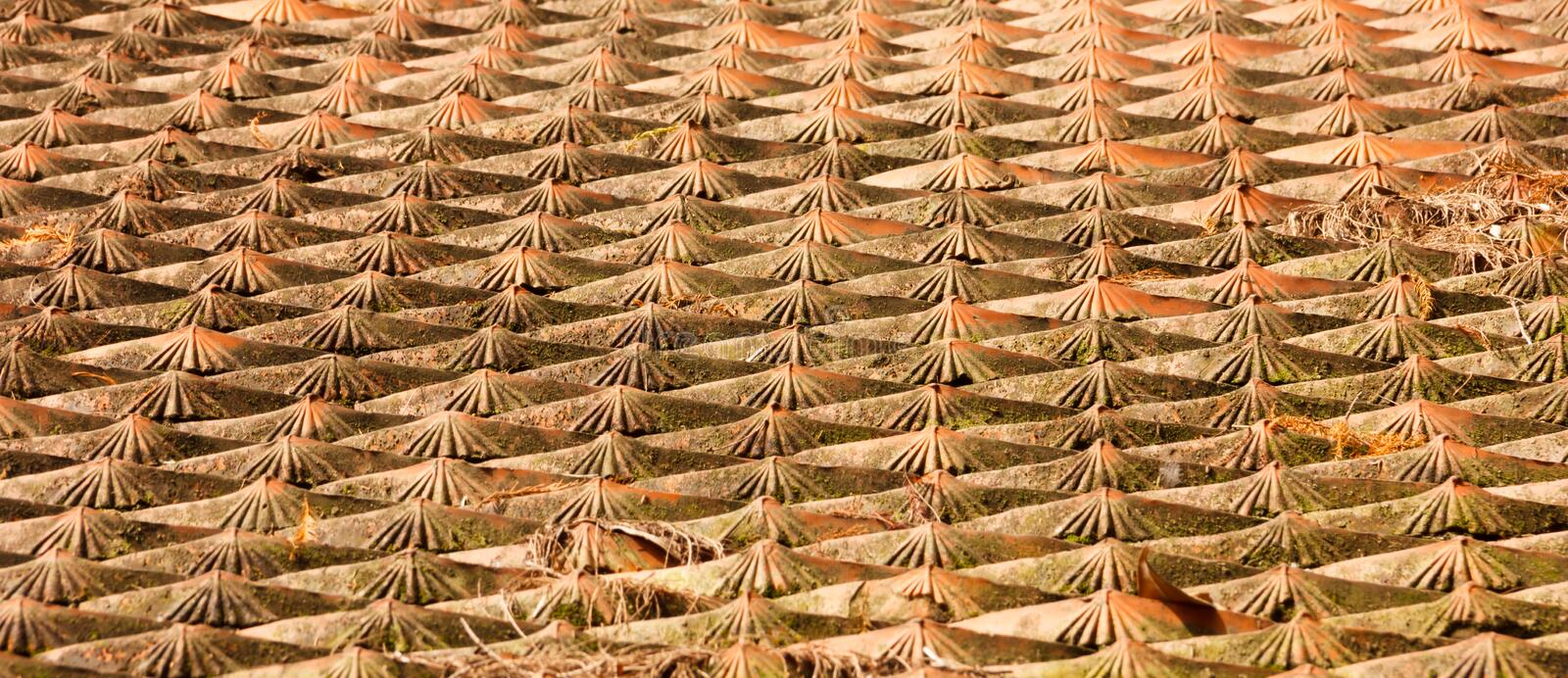 Aged traditional asian roof tile pattern background. Exterior architectural oriental design stock photography