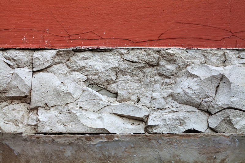 Aged wall. red white paint background with cracks craquelure fractures. macro view selective focus. Aged wall. red white paint wall background with cracks stock images