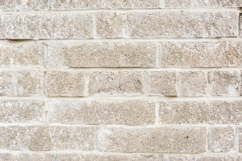aged weathered block wall. old brick background stock photos