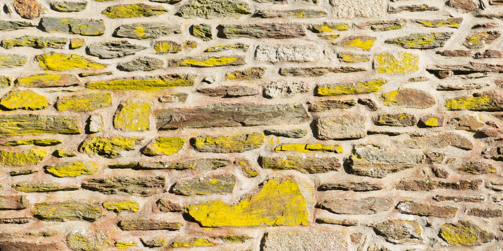 Aged weathered stone wall background royalty free stock images