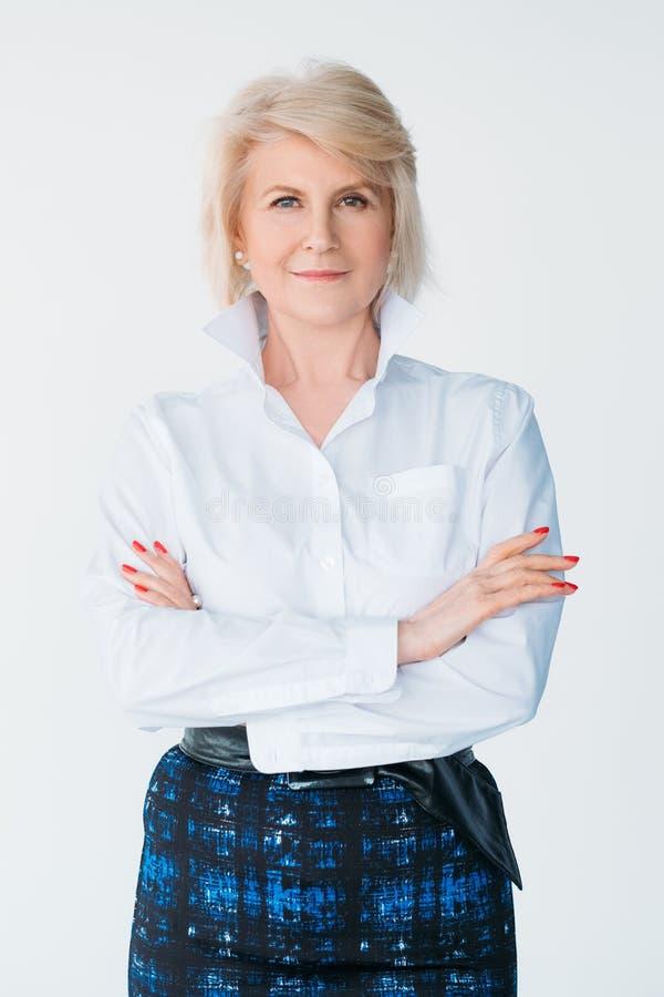 Aged woman confidence elegance stylish arms folded royalty free stock image