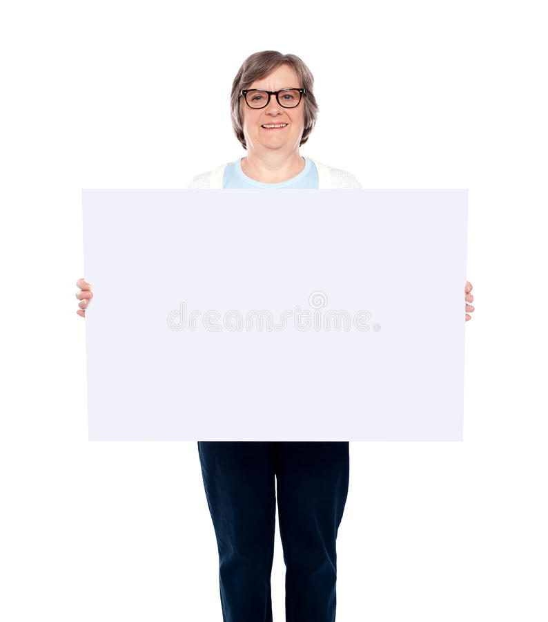 Download Aged Woman Displaying Blank Poster Stock Photos - Image: 25621813