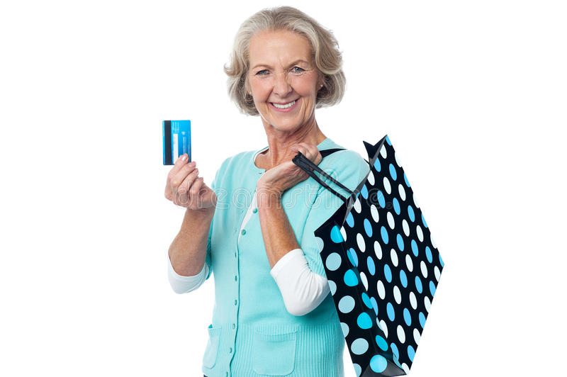 Download Aged Woman Displaying Her Cash Card Stock Image - Image: 33593105