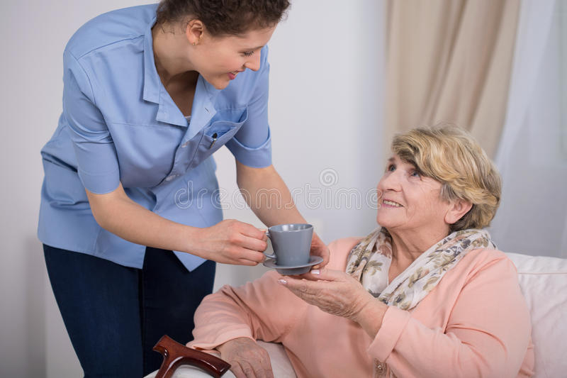 Aged woman and tea time royalty free stock images