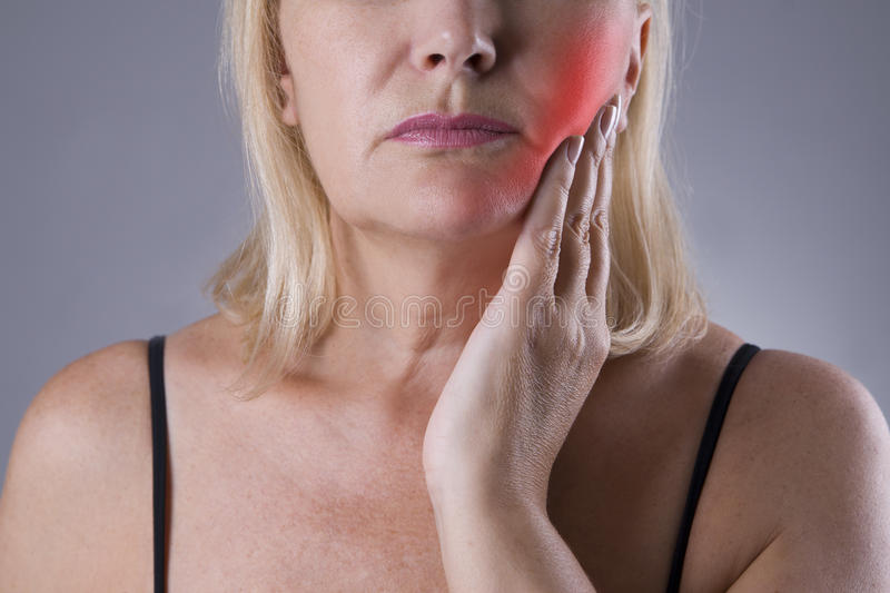 Aged woman with toothache, teeth pain closeup stock image