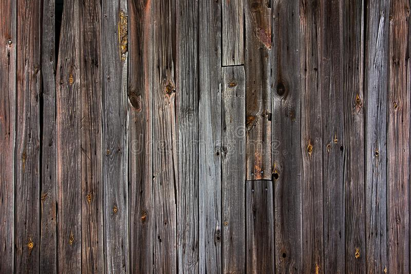 Aged wood boards wall background. Dark texture backdrop royalty free stock photo