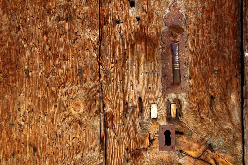 Aged wood door grunge texture rusty handle stock images