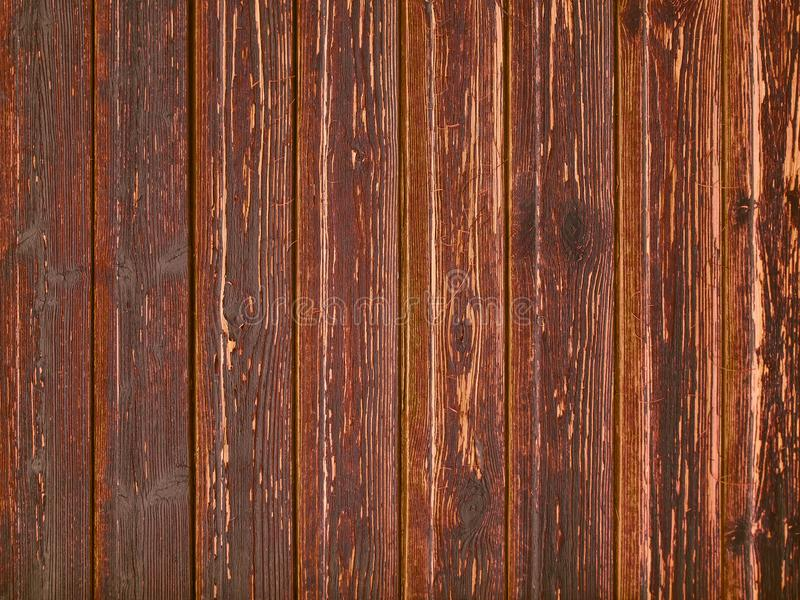 Aged wood shabby planks with red peeled paint royalty free stock photos