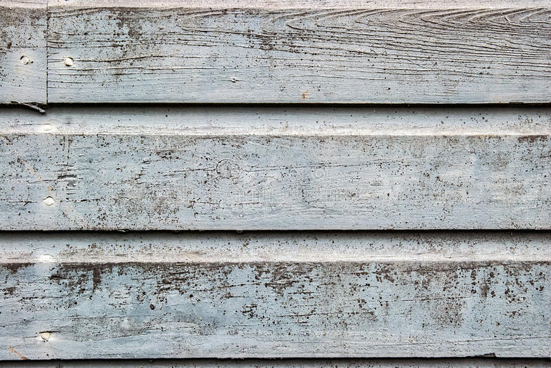 Aged wood siding with worn paint stock images