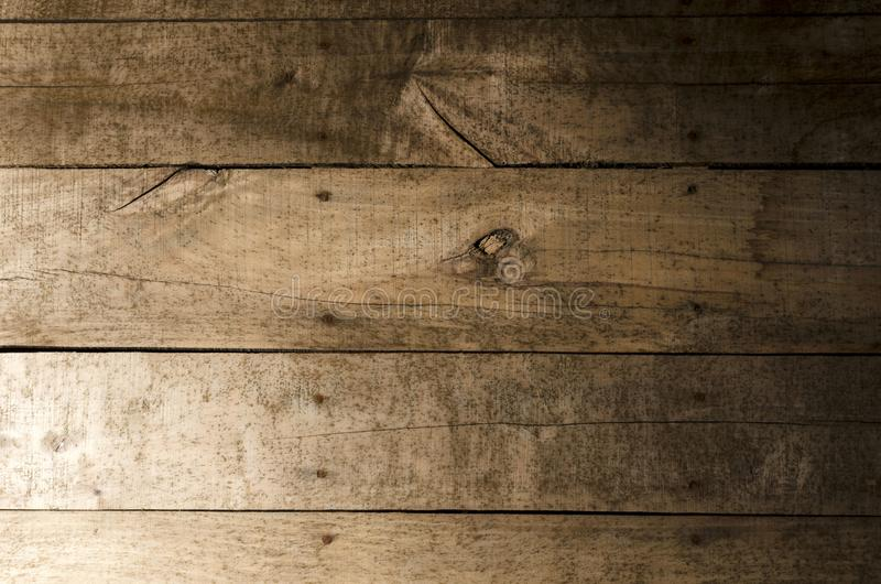 Weathered wood background. Aged wood slat wall illuminated from the left side with the right side in shadow royalty free stock photo