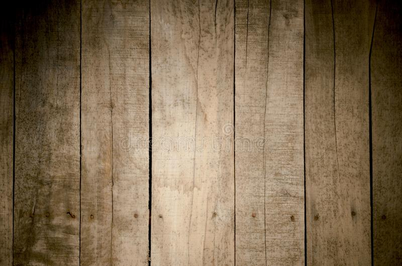 Weathered wood background. Aged wood slat wall in shadow illuminated from the right side stock photos