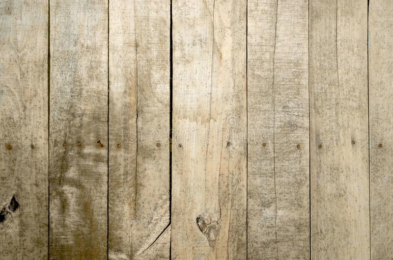 Weathered wood background. Aged wood slat wall in shadow illuminated from the top stock images