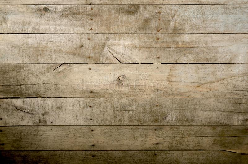 Weathered wood background. Aged wood slat wall in shadow illuminated from the top royalty free stock photos